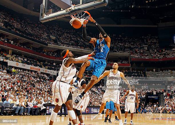 Dwight Howard of the Orlando Magic dunks against Stephen Jackson of the Charlotte Bobcats in Game Three of the Eastern Conference Quarterfinals...