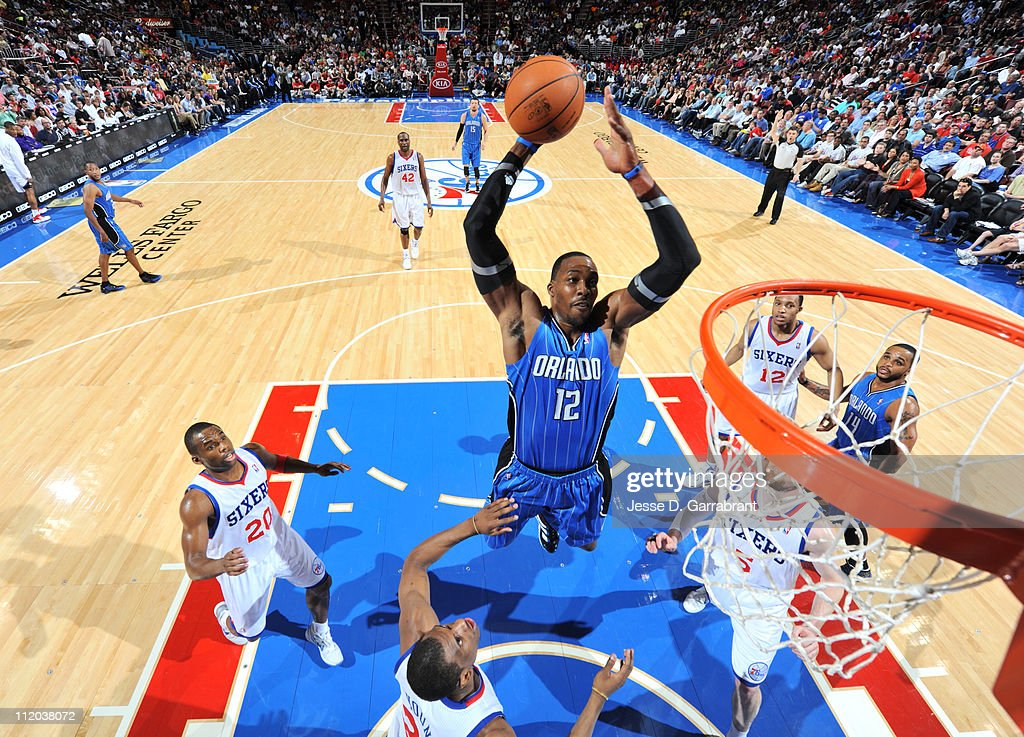 <a gi-track='captionPersonalityLinkClicked' href=/galleries/search?phrase=Dwight+Howard&family=editorial&specificpeople=201570 ng-click='$event.stopPropagation()'>Dwight Howard</a> #12 of the Orlando Magic dunks against <a gi-track='captionPersonalityLinkClicked' href=/galleries/search?phrase=Thaddeus+Young&family=editorial&specificpeople=3847270 ng-click='$event.stopPropagation()'>Thaddeus Young</a> #21 of the Philadelphia 76ers on April 11, 2011 at the Wells Fargo Center in Philadelphia, Pennsylvania.