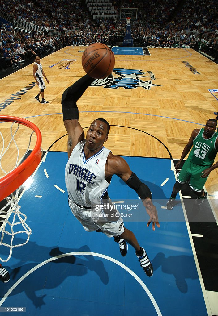 <a gi-track='captionPersonalityLinkClicked' href=/galleries/search?phrase=Dwight+Howard&family=editorial&specificpeople=201570 ng-click='$event.stopPropagation()'>Dwight Howard</a> #12 of the Orlando Magic dunks against the Boston Celtics in Game Five of the Eastern Conference Finals during the 2010 NBA Playoffs on May 26, 2010 at Amway Arena in Orlando, Florida.