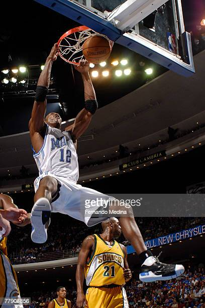 Dwight Howard of the Orlando Magic dunks against the Seattle Supersonics at Amway Arena on November 13 2007 in Orlando Florida NOTE TO USER User...