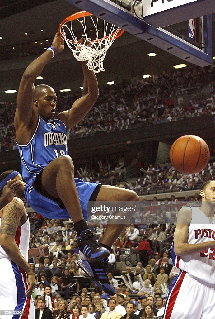 Dwight Howard #12 of the Orlando Magic dunks in front of Tayshaun Prince #22 and Rasheed Wallace #36 of the Detroit Pistons in game one of the Eastern Conference Quarterfinals during the 2007 NBA Playoffs at the Palace of Aubrun Hills on April 21, 2007 in Auburn Hills, Michigan.