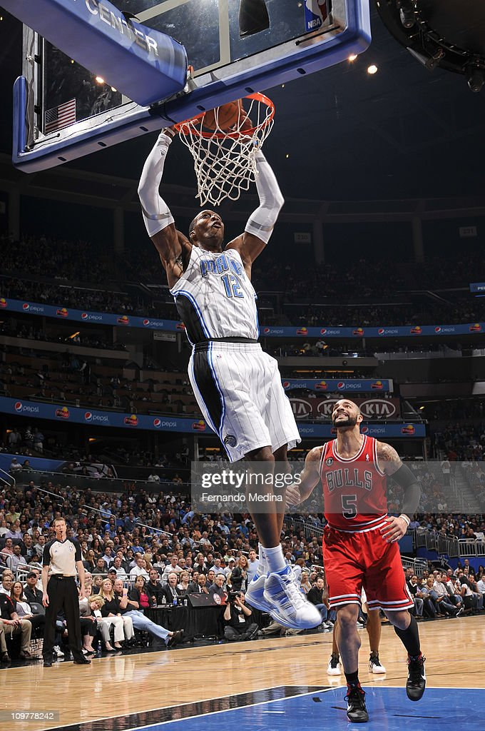 <a gi-track='captionPersonalityLinkClicked' href=/galleries/search?phrase=Dwight+Howard&family=editorial&specificpeople=201570 ng-click='$event.stopPropagation()'>Dwight Howard</a> #12 of the Orlando Magic dunks over <a gi-track='captionPersonalityLinkClicked' href=/galleries/search?phrase=Carlos+Boozer&family=editorial&specificpeople=201638 ng-click='$event.stopPropagation()'>Carlos Boozer</a> #5 of the Chicago Bulls on March 4, 2011 at the Amway Center in Orlando, Florida.