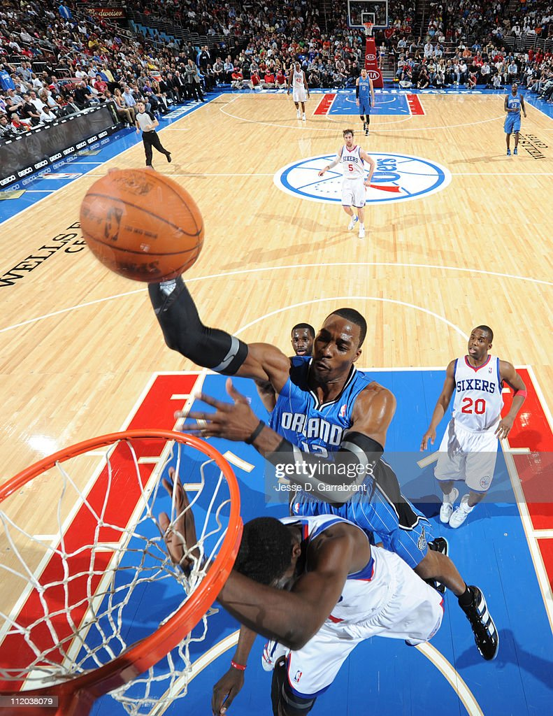 <a gi-track='captionPersonalityLinkClicked' href=/galleries/search?phrase=Dwight+Howard&family=editorial&specificpeople=201570 ng-click='$event.stopPropagation()'>Dwight Howard</a> #12 of the Orlando Magic dunks over <a gi-track='captionPersonalityLinkClicked' href=/galleries/search?phrase=Jrue+Holiday&family=editorial&specificpeople=5042484 ng-click='$event.stopPropagation()'>Jrue Holiday</a> #11 of the Philadelphia 76ers on April 11, 2011 at the Wells Fargo Center in Philadelphia, Pennsylvania.