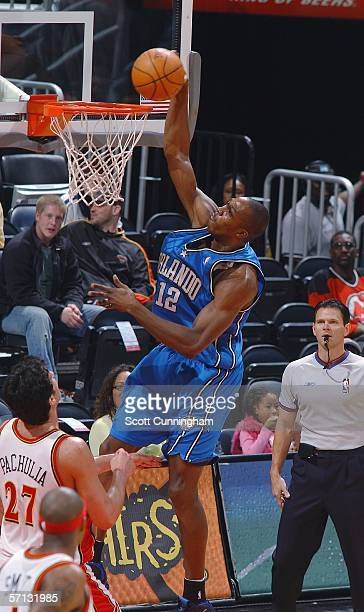 Dwight Howard of the Orlando Magic dunks over Zaza Pachulia of the Atlanta Hawks on March 19 2006 at Philips Arena in Atlanta Georgia NOTE TO USER...
