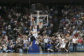 Dwight Howard of the Orlando Magic dunks the game winning shot against the San Antonio Spurs on February 9 2007 at Amway Arena in Orlando Florida...