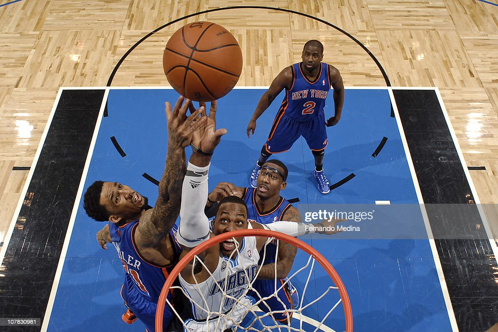 Dwight Howard of the Orlando Magic fights for a rebound against Wilson Chandler of the New York Knicks on December 30 2010 at the Amway Center in...