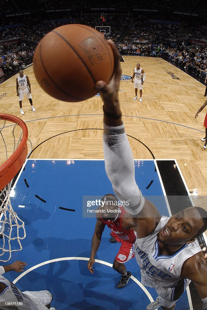 Dwight Howard #12 of the Orlando Magic goes in for a dunk as Reggie Evans #30 of the Los Angeles Clippers looks on during the game on February 6, 2012 at Amway Center in Orlando, Florida.