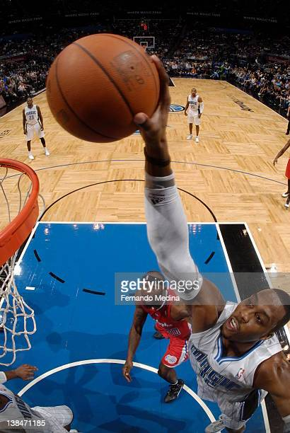 Dwight Howard of the Orlando Magic goes in for a dunk as Reggie Evans of the Los Angeles Clippers looks on during the game on February 6 2012 at...
