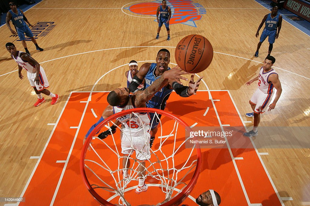 <a gi-track='captionPersonalityLinkClicked' href=/galleries/search?phrase=Dwight+Howard&family=editorial&specificpeople=201570 ng-click='$event.stopPropagation()'>Dwight Howard</a> #12 of the Orlando Magic goes to the basket against <a gi-track='captionPersonalityLinkClicked' href=/galleries/search?phrase=Tyson+Chandler&family=editorial&specificpeople=202061 ng-click='$event.stopPropagation()'>Tyson Chandler</a> #6 of the New York Knicks during the game on March 28, 2012 at Madison Square Garden in New York City.