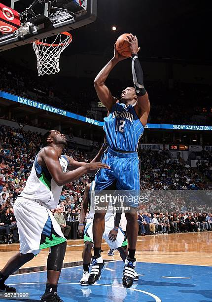 Dwight Howard of the Orlando Magic goes up for a shot against Al Jefferson of the Minnesota Timberwolves during the game at Target Center on January...