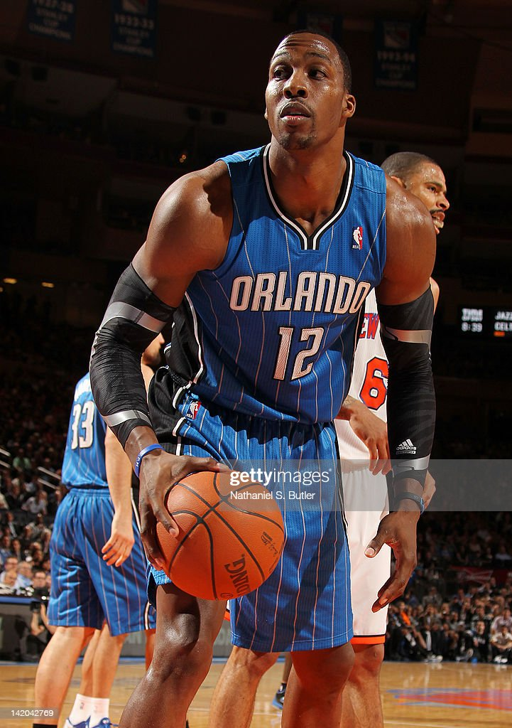 <a gi-track='captionPersonalityLinkClicked' href=/galleries/search?phrase=Dwight+Howard&family=editorial&specificpeople=201570 ng-click='$event.stopPropagation()'>Dwight Howard</a> #12 of the Orlando Magic grabs the ball during the game against the New York Knicks on March 28, 2012 at Madison Square Garden in New York City.