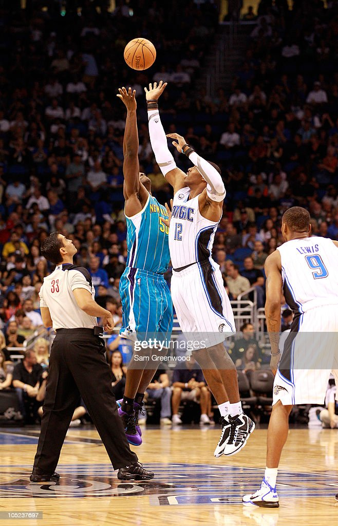 <a gi-track='captionPersonalityLinkClicked' href=/galleries/search?phrase=Dwight+Howard&family=editorial&specificpeople=201570 ng-click='$event.stopPropagation()'>Dwight Howard</a> #12 of the Orlando Magic jumps against <a gi-track='captionPersonalityLinkClicked' href=/galleries/search?phrase=Emeka+Okafor&family=editorial&specificpeople=201739 ng-click='$event.stopPropagation()'>Emeka Okafor</a> #50 of the New Orleans Hornets during the game at Amway Arena on October 10, 2010 in Orlando, Florida.