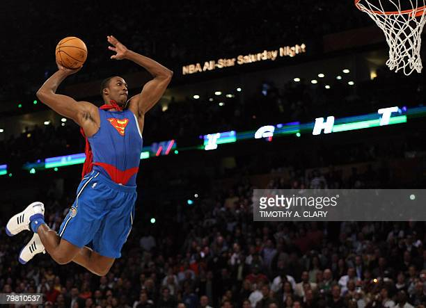 Dwight Howard of the Orlando Magic jumps wearing a Superman Cape in the Sprite SlamDunk Contest at the New Orleans Arena during the 2008 NBA AllStar...