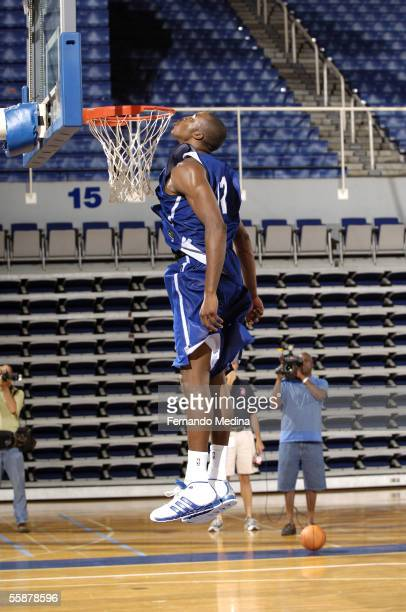 Dwight Howard of the Orlando Magic leaps up vertically to kiss the rim during the second day of the training camp at the University of North Florida...
