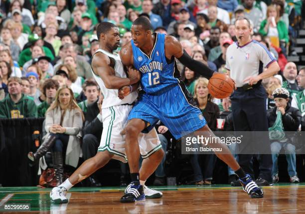 Dwight Howard of the Orlando Magic looks for the play against Leon Powe of the Boston Celtics on March 8 2009 at the TD Banknorth Garden in Boston...