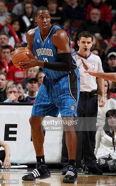 Dwight Howard of the Orlando Magic moves the ball during the game against the Chicago Bulls at the United Center on December 31 2008 in Chicago...