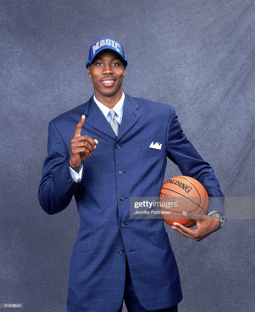<a gi-track='captionPersonalityLinkClicked' href=/galleries/search?phrase=Dwight+Howard&family=editorial&specificpeople=201570 ng-click='$event.stopPropagation()'>Dwight Howard</a> of the Orlando Magic poses during the 2004 NBA Draft Portraits at Madison Square Garden on June 24 in New York, New York.