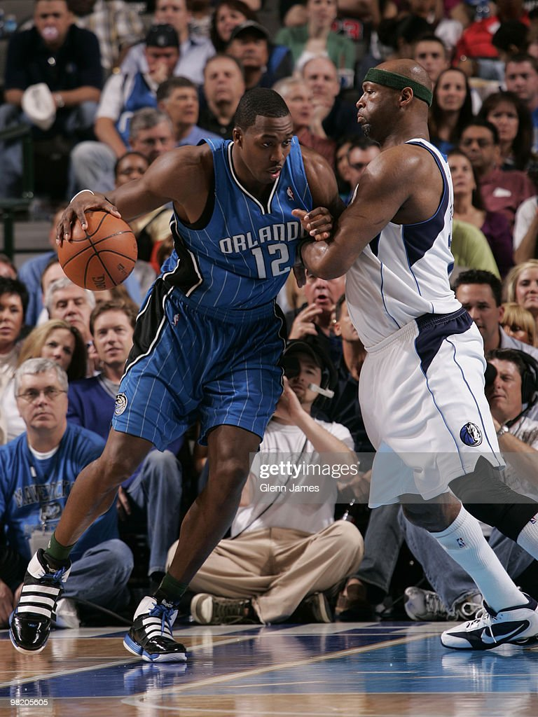 Dwight Howard #12 of the Orlando Magic posts up against Erick Dampier #25 of the Dallas Mavericks during a game at the American Airlines Center on April 1, 2010 in Dallas, Texas.
