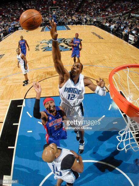 Dwight Howard of the Orlando Magic reaches to block a shot against Richard Hamilton of the Detroit Pistons during the game on February 17 2010 at...
