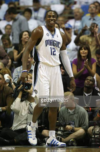Dwight Howard of the Orlando Magic reacts after drawing a foul against the Cleveland Cavaliers in Game Six of the Eastern Conference Finals during...