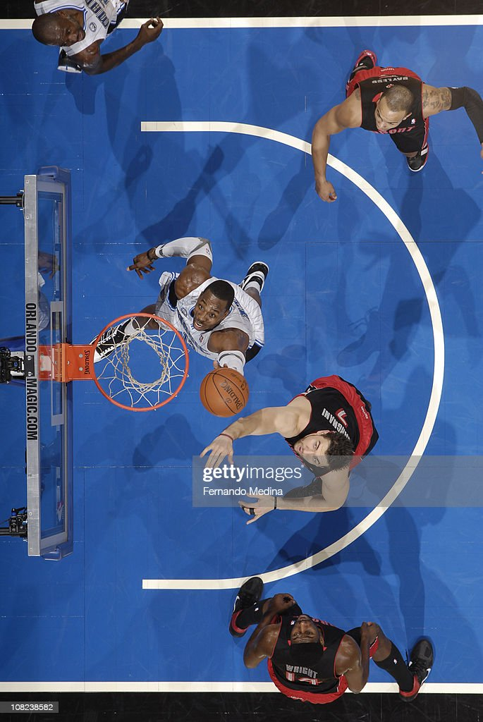 <a gi-track='captionPersonalityLinkClicked' href=/galleries/search?phrase=Dwight+Howard&family=editorial&specificpeople=201570 ng-click='$event.stopPropagation()'>Dwight Howard</a> #12 of the Orlando Magic rebounds against <a gi-track='captionPersonalityLinkClicked' href=/galleries/search?phrase=Andrea+Bargnani&family=editorial&specificpeople=533014 ng-click='$event.stopPropagation()'>Andrea Bargnani</a> #7 of the Toronto Raptors on January 21, 2011 at the Amway Center in Orlando, Florida.