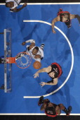 Dwight Howard of the Orlando Magic rebounds against Andrea Bargnani of the Toronto Raptors on January 21 2011 at the Amway Center in Orlando Florida...