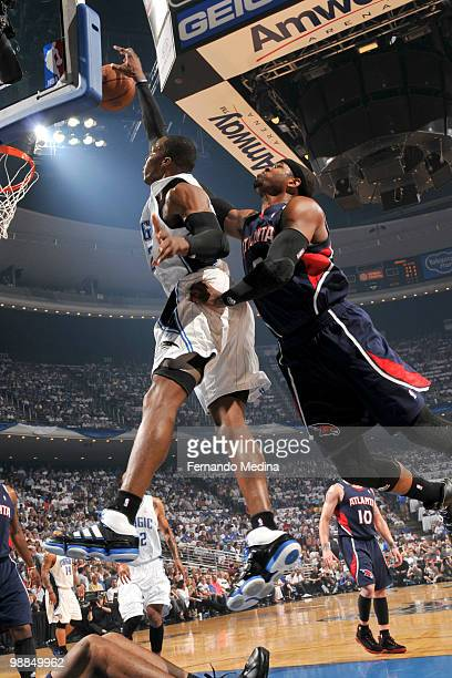 Dwight Howard of the Orlando Magic rebounds against Josh Smith of the Atlanta Hawks in Game One of the Eastern Conference Semifinals during the 2010...