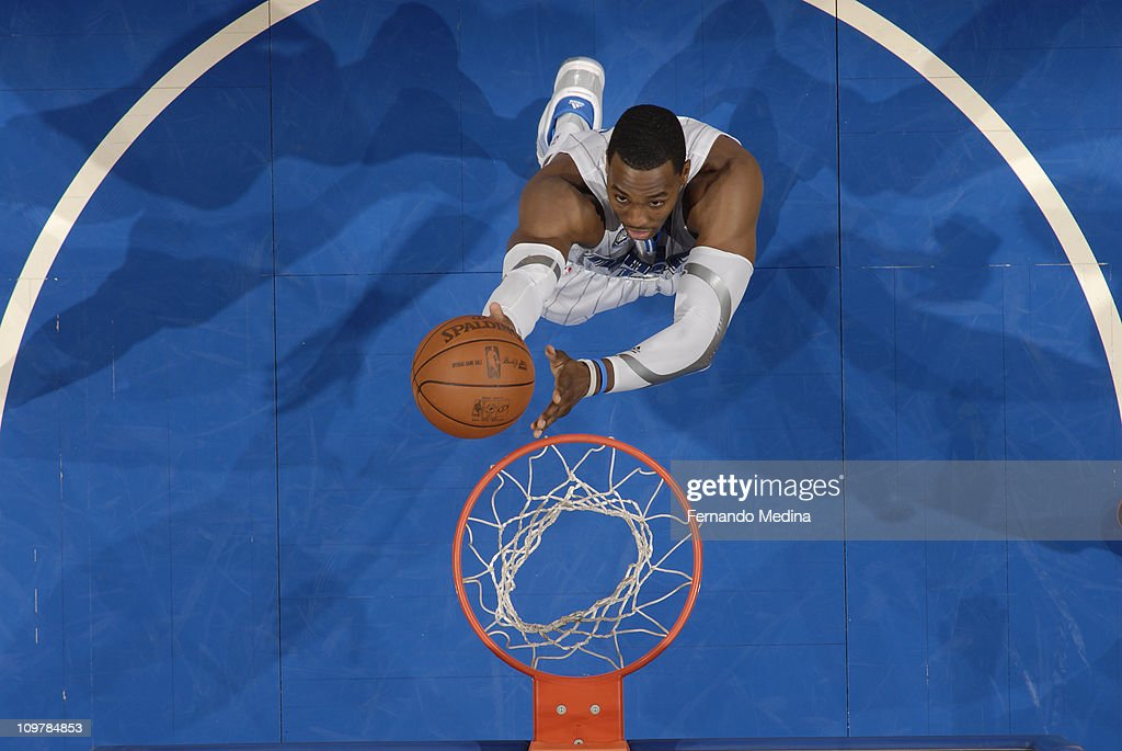 <a gi-track='captionPersonalityLinkClicked' href=/galleries/search?phrase=Dwight+Howard&family=editorial&specificpeople=201570 ng-click='$event.stopPropagation()'>Dwight Howard</a> #12 of the Orlando Magic rebounds against the Chicago Bulls on March 4, 2011 at the Amway Center in Orlando, Florida.