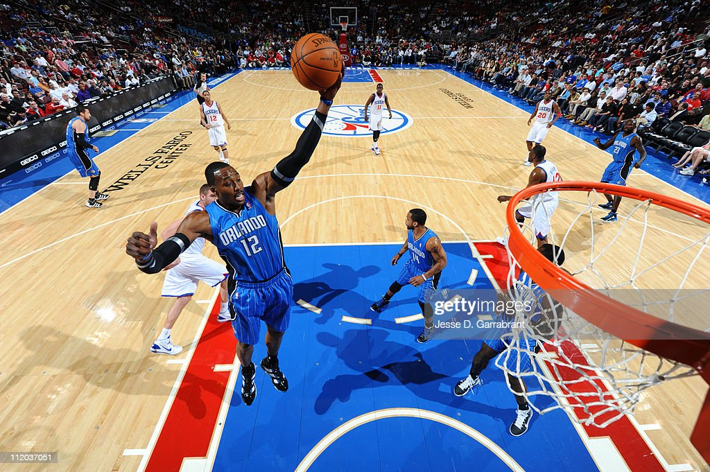<a gi-track='captionPersonalityLinkClicked' href=/galleries/search?phrase=Dwight+Howard&family=editorial&specificpeople=201570 ng-click='$event.stopPropagation()'>Dwight Howard</a> #12 of the Orlando Magic rebounds against the Philadelphia 76ers on April 11, 2011 at the Wells Fargo Center in Philadelphia, Pennsylvania.