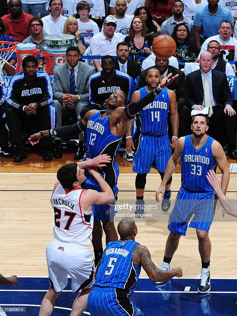 <a gi-track='captionPersonalityLinkClicked' href=/galleries/search?phrase=Dwight+Howard&family=editorial&specificpeople=201570 ng-click='$event.stopPropagation()'>Dwight Howard</a> #12 of the Orlando Magic rebounds against <a gi-track='captionPersonalityLinkClicked' href=/galleries/search?phrase=Zaza+Pachulia&family=editorial&specificpeople=202939 ng-click='$event.stopPropagation()'>Zaza Pachulia</a> #27 of the Atlanta Hawks in Game Three of the Eastern Conference Quarterfinals in the 2011 NBA Playoffs on April 22, 2011 at Philips Arena in Atlanta, Georgia.