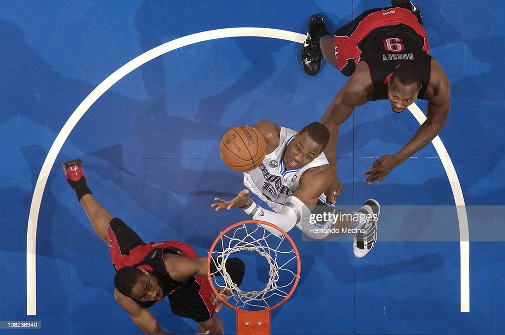 <a gi-track='captionPersonalityLinkClicked' href=/galleries/search?phrase=Dwight+Howard&family=editorial&specificpeople=201570 ng-click='$event.stopPropagation()'>Dwight Howard</a> #12 of the Orlando Magic shoots against <a gi-track='captionPersonalityLinkClicked' href=/galleries/search?phrase=Joey+Dorsey&family=editorial&specificpeople=728526 ng-click='$event.stopPropagation()'>Joey Dorsey</a> #9 of the Toronto Raptors on January 21, 2011 at the Amway Center in Orlando, Florida.