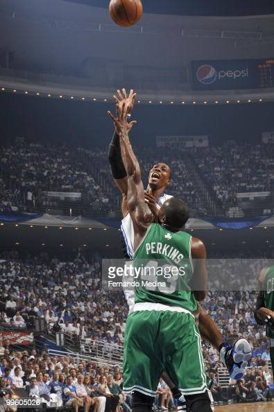 Dwight Howard of the Orlando Magic shoots against Kendrick Perkins of the Boston Celtics in Game One of the Eastern Conference Finals during the 2010...