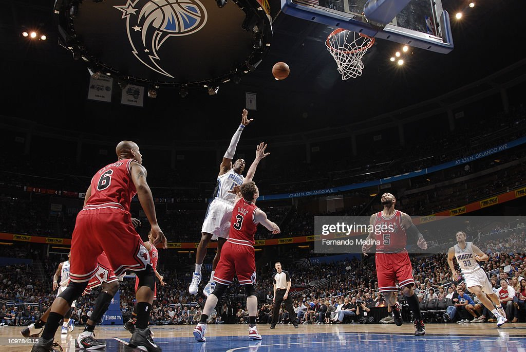<a gi-track='captionPersonalityLinkClicked' href=/galleries/search?phrase=Dwight+Howard&family=editorial&specificpeople=201570 ng-click='$event.stopPropagation()'>Dwight Howard</a> #12 of the Orlando Magic shoots over Omer Asik #3 of the Chicago Bulls on March 4, 2011 at the Amway Center in Orlando, Florida.