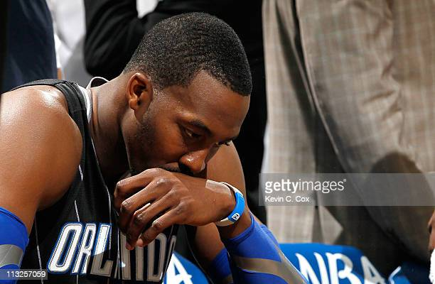 Dwight Howard of the Orlando Magic sits on the bench during a timeout before the final seconds against the Atlanta Hawks during Game Six of the...