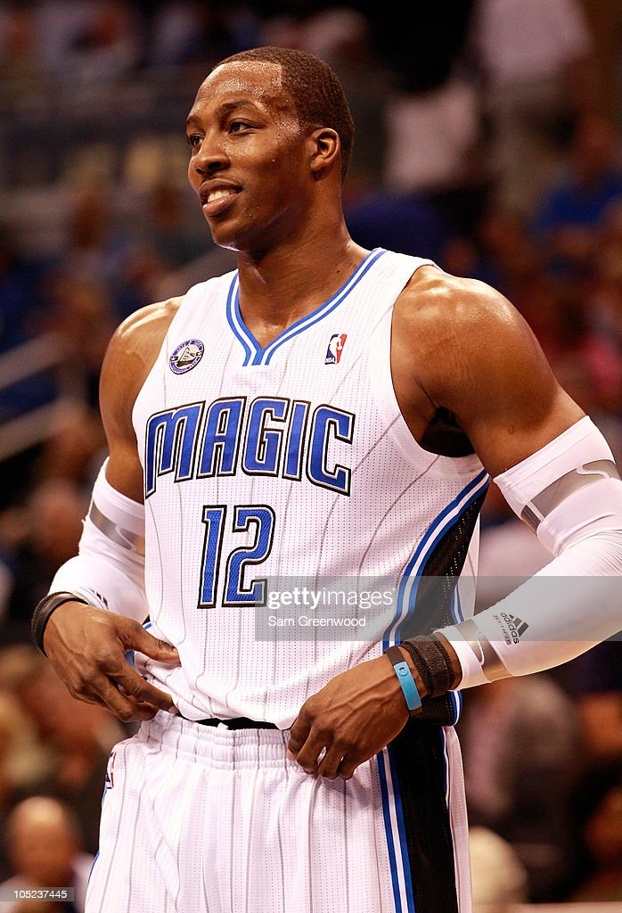 <a gi-track='captionPersonalityLinkClicked' href=/galleries/search?phrase=Dwight+Howard&family=editorial&specificpeople=201570 ng-click='$event.stopPropagation()'>Dwight Howard</a> #12 of the Orlando Magic smiles during the game against the New Orleans Hornets at Amway Arena on October 10, 2010 in Orlando, Florida.
