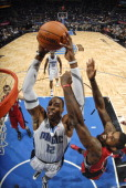 Dwight Howard of the Orlando Magic takes the ball to the basket against Amir Johnson of the Toronto Raptors on November 12 2010 at the Amway Center...