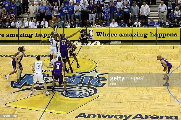 Dwight Howard of the Orlando Magic tips off against Andrew Bynum of the Los Angeles Lakers to start Game Three of the 2009 NBA Finals on June 9 2009...