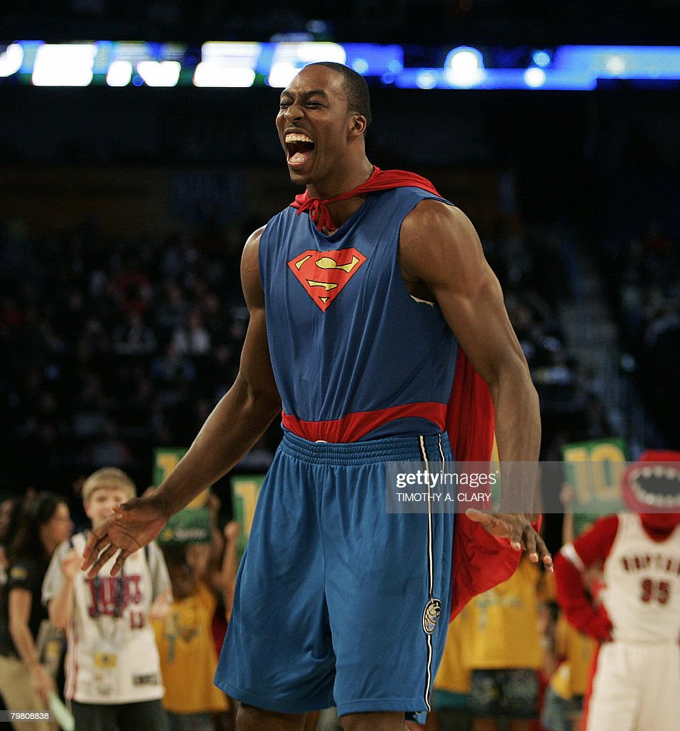 <a gi-track='captionPersonalityLinkClicked' href=/galleries/search?phrase=Dwight+Howard&family=editorial&specificpeople=201570 ng-click='$event.stopPropagation()'>Dwight Howard</a> of the Orlando Magic wearing a Superman Cape in the Sprite Slam-Dunk Contest laughs at the New Orleans Arena during the 2008 NBA All-Star Weekend February 16, 2008 in New Orleans, Louisiana.