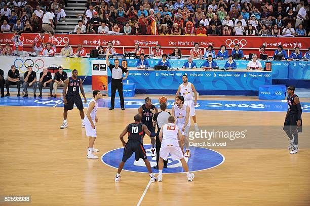 Dwight Howard of the United States and Pau Gasol of Spain line up for the jump ball during the gold medal game at the 2008 Beijing Summer Olympics at...