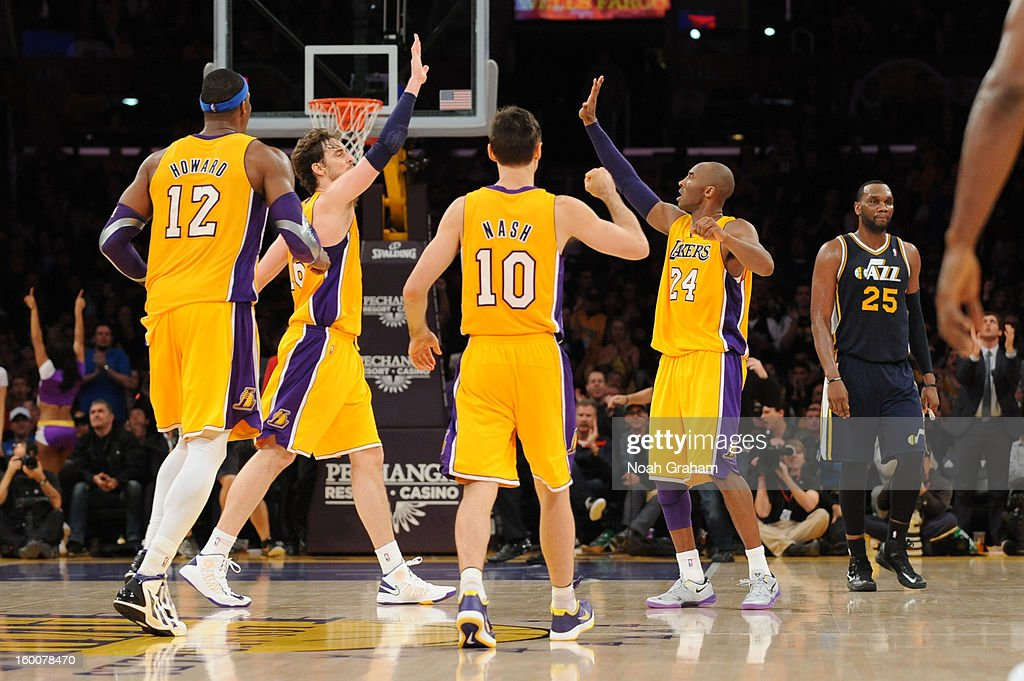 Dwight Howard #12, Pau Gasol #16, Steve Nash #10, and Kobe Bryant #24 of the Los Angeles Lakers celebrate during their game against the Utah Jazz at Staples Center on January 25, 2013 in Los Angeles, California.