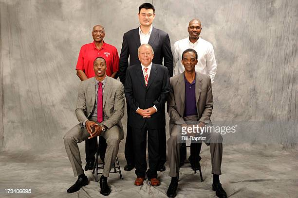 Dwight Howard poses for a photo along with Leslie Alexander owner and the newest Rocket by Rockets center legends Hakeem Olajuwon Elvin Hays Ralph...