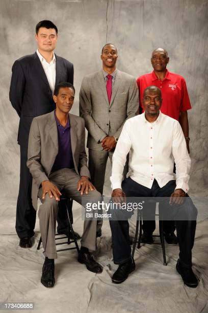 Dwight Howard poses for a photo as the newest Rocket by Rockets center legends Hakeem Olajuwon Elvin Hays Ralph Sampson and Yao Ming were in...