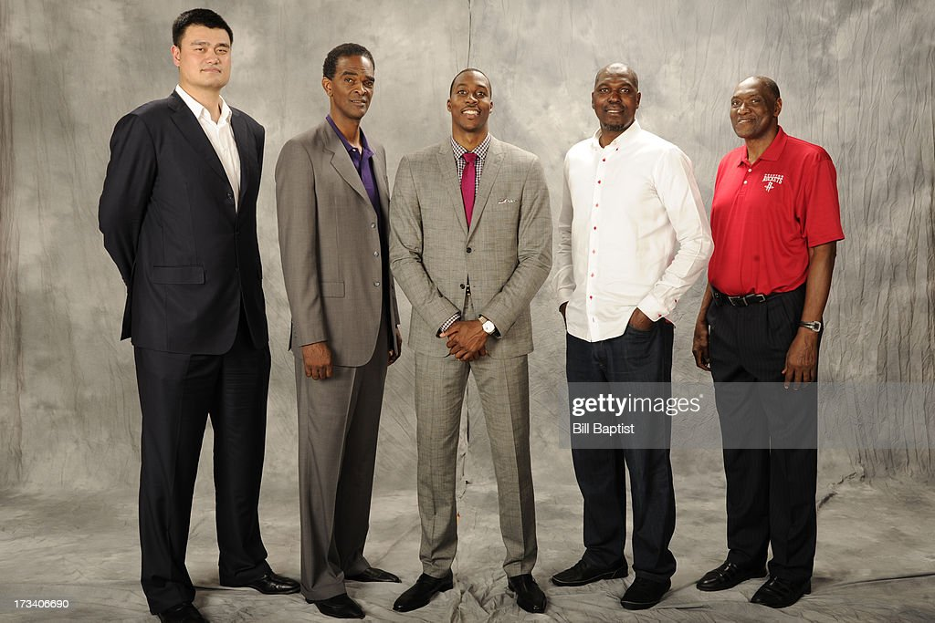 <a gi-track='captionPersonalityLinkClicked' href=/galleries/search?phrase=Dwight+Howard&family=editorial&specificpeople=201570 ng-click='$event.stopPropagation()'>Dwight Howard</a> #12 poses for a photo as the newest Rocket by Rockets center legends <a gi-track='captionPersonalityLinkClicked' href=/galleries/search?phrase=Hakeem+Olajuwon&family=editorial&specificpeople=202637 ng-click='$event.stopPropagation()'>Hakeem Olajuwon</a>, Elvin Hays, <a gi-track='captionPersonalityLinkClicked' href=/galleries/search?phrase=Ralph+Sampson&family=editorial&specificpeople=214741 ng-click='$event.stopPropagation()'>Ralph Sampson</a> and <a gi-track='captionPersonalityLinkClicked' href=/galleries/search?phrase=Yao+Ming&family=editorial&specificpeople=201476 ng-click='$event.stopPropagation()'>Yao Ming</a> were in attendance to welcome him to the Rockets on July 13, 2013 at The Toyota Center Houston, Texas.