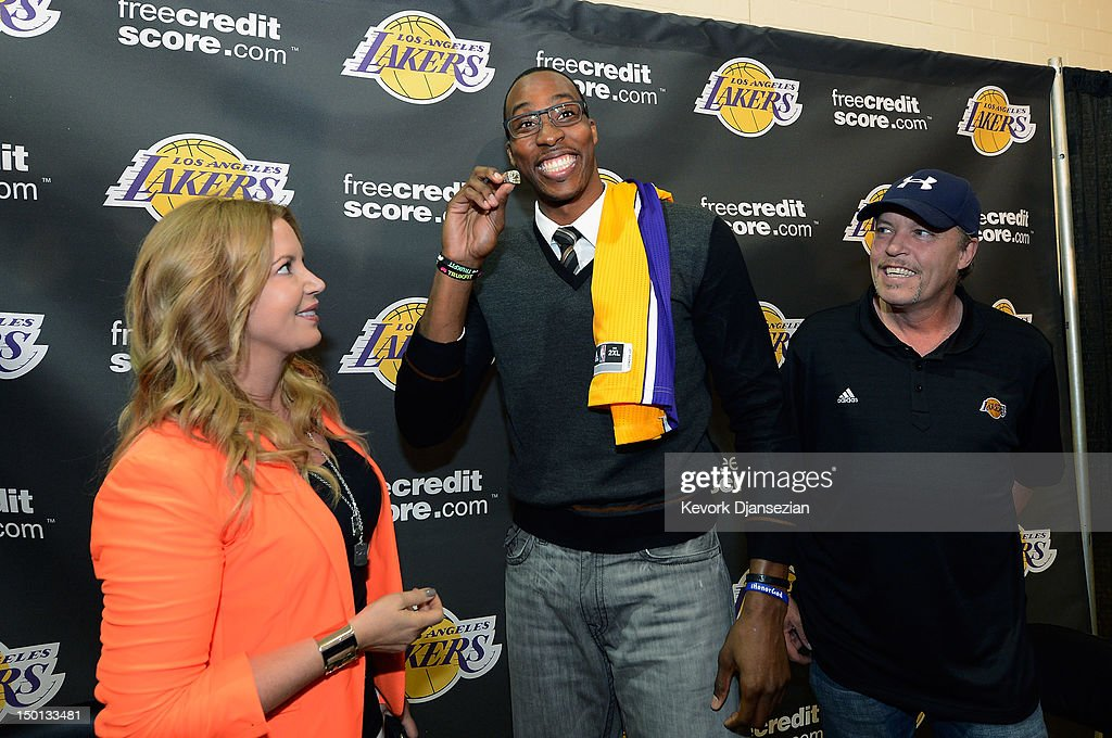 Dwight Howard (C) shows the Los Angeles Lakers 2002 NBA Finals ring given to him by Jeanie Buss (R) as her brother Jim Buss looks on after Howard was introduced to the media as the newest member of the Los Angeles Lakers at the Toyota Sports Center on August 10, 2012 in El Segundo, California. The Lakers acquired Howard from Orlando Magic in a four-team trade. In addition Lakers wil receive Chris Duhon and Earl Clark from the Magic.