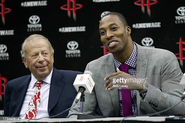Dwight Howard takes questions during a press conference with Houston Rockets owner Les Alexander introducing him as a Houston Rocket at the Toyota...