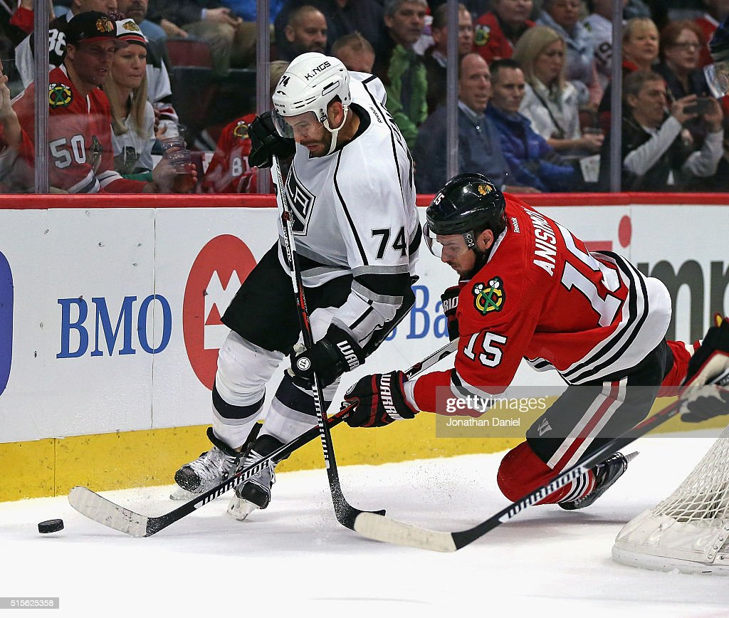 Dwight King of the Los Angeles Kings and Artem Anisimov of the Chicago Blackhawks battle for the puck at the United Center on March 14 2016 in...
