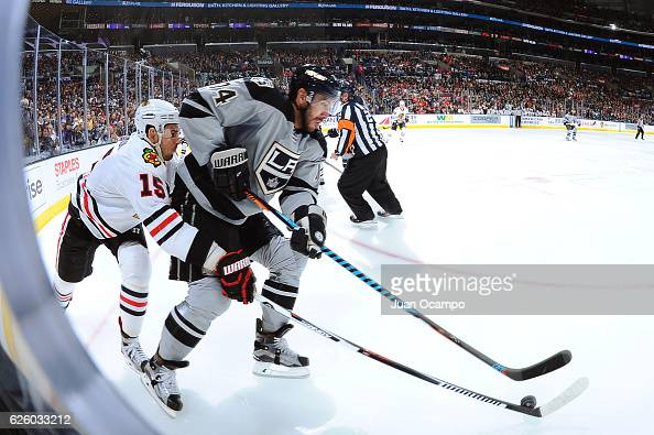 Dwight King of the Los Angeles Kings battles for the puck against Artem Anisimov of the Chicago Blackhawks during the game on November 26 2016 at...