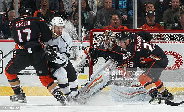 Dwight King of the Los Angeles Kings battles Ryan Kesler of the Anaheim Ducks for position as goalie John Gibson and Francois Beauchemin of the Ducks...