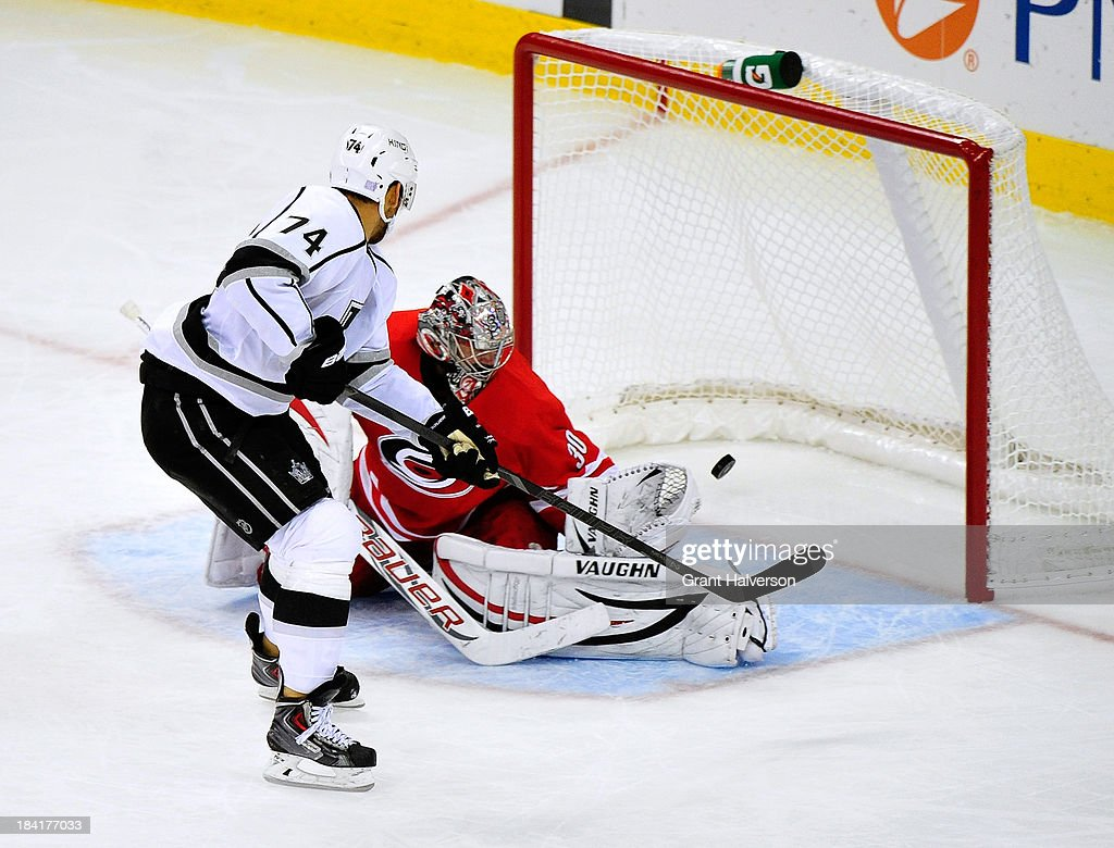 <a gi-track='captionPersonalityLinkClicked' href=/galleries/search?phrase=Dwight+King+-+Ice+Hockey+Player&family=editorial&specificpeople=4537297 ng-click='$event.stopPropagation()'>Dwight King</a> #74 of the Los Angeles Kings beats <a gi-track='captionPersonalityLinkClicked' href=/galleries/search?phrase=Cam+Ward&family=editorial&specificpeople=453216 ng-click='$event.stopPropagation()'>Cam Ward</a> #30 of the Carolina Hurricanes for a goal during the third period at PNC Arena on October 11, 2013 in Raleigh, North Carolina. The Kings won 2-1 in a shootout.