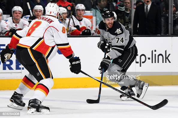 Dwight King of the Los Angeles Kings calls for a pass against Nicklas Grossmann of the Calgary Flames on November 5 2016 at Staples Center in Los...